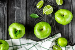 Summer food with green apples on dark background top view. Summer food with green apples on dark table background top view Royalty Free Stock Photo