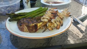 Summer food. Grilled steak shrimp and asparagus Royalty Free Stock Photography