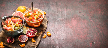 Summer food. Tropical salad of exotic fruits. Royalty Free Stock Photography
