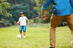 Summer football. Dad and son playing soccer. Stock Photography