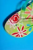 Summer footwear. Green flipflops for summer footwear Stock Images