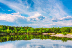Summer Forest And River Under Blue Sky Stock Images