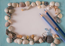Summer frame with seashells and pen Royalty Free Stock Photos