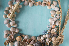 Summer frame with seashells Stock Photos