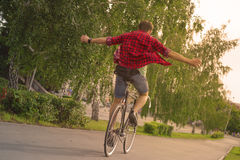 Summer freedom. Biker ride away with no hands Stock Image