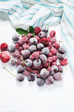 Summer fresh berries, healthy food, white wooden background. Stock Photo