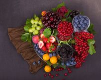 Free Summer Fresh Berries Of Different Types On A Black Background Royalty Free Stock Image - 155675566