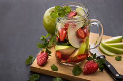 Summer fresh fruit drink. fruit Flavored water mix with strawber Stock Image