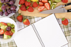 Summer fresh fruit salad background, notebook, copy space Stock Photos