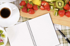 Summer fresh fruit salad background with notebook, copy space Royalty Free Stock Photo