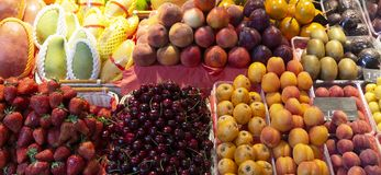Summer fresh seasonal fruits,  and berries on the market royalty free stock photography