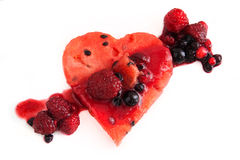 Summer Fruit. Heartshaped piece of watermelon topped with fruit-salad Royalty Free Stock Photography