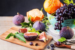 Summer Fruit Background with Grape, Orange and Figs Royalty Free Stock Photos