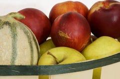 Summer Fruit Basket. Melon, nectarine and apples Stock Photos