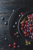 Summer fruit on black wooden table Royalty Free Stock Images
