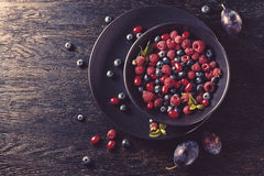 Summer fruit on black wooden table. Healthy lifestyle concept, Top view horizontal Stock Photos