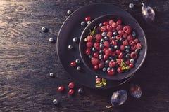 Summer fruit on black wooden table Stock Photos