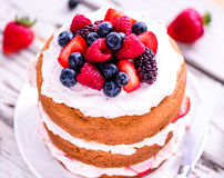 Summer fruit cake with berries and cream. Summer fruit cake with berries and whipped cream royalty free stock photo