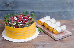 A summer fruit cake rolled in  yellow biscuit Royalty Free Stock Images