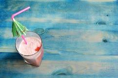Summer fruit cocktail on blue wooden background stock images