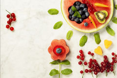 Summer fruit concept. Watermelon, fruits, berries and mint leave Royalty Free Stock Photos