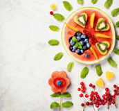 Summer fruit concept. Watermelon, fruits, berries and mint leave Stock Photos