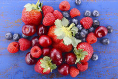 Summer fruit on dark blue wood table. Royalty Free Stock Image