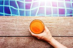 Summer Fruit Drink. Woman Relaxing at the Swimming Pool in her V stock photography