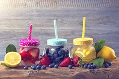 Summer fruit drinks. On a wooden table stock photography