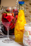 Summer fruit painted cocktails, lemonade, wine in glass, studio photo stock images