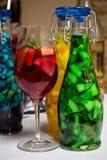 Summer fruit painted cocktails, lemonade, wine in glass, studio photo Stock Photo