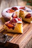 Summer fruit pie. With fresh plums on rustic wooden table stock photography