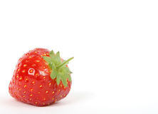 Summer fruit salad ingredients, red strawberry with green stalk Royalty Free Stock Image