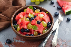 Summer fruit salad. With watermelon, blueberry and grapes. Space for text Stock Image