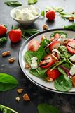 Summer Fruit Strawberry, spinach Salad with walnut, feta cheese balsamic vinegar, kale. in a plate. concepts health food Royalty Free Stock Photos