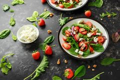 Summer Fruit Strawberry, spinach Salad with walnut, feta cheese balsamic vinegar, kale. in a plate. concepts health food Royalty Free Stock Image