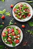 Summer Fruit Strawberry, spinach Salad with walnut, feta cheese balsamic vinegar, kale. in a plate. concepts health food royalty free stock photo