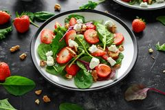 Summer Fruit Strawberry, spinach Salad with walnut, feta cheese balsamic vinegar, kale. in a plate. concepts health food.  Royalty Free Stock Images