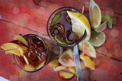 Summer fruit tea with lemon Stock Photos