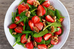Summer Fruit Vegan Spinach Strawberry nuts Salad. concepts health food.  Royalty Free Stock Image