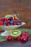 Summer Fruit in Vintage Bowl on Dark Wood Table. Royalty Free Stock Images