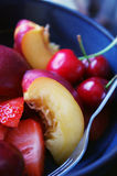Summer Fruits. Cut into pieces in a bowl, with a fork Royalty Free Stock Photography