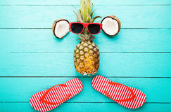 Summer fruits and accessories on blue wooden background. Top view. And selective focus Royalty Free Stock Photos
