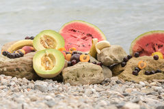 Summer fruits against the waves. Royalty Free Stock Photography