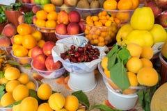 Summer fruits - apples, tangerines, kumquats, peaches. Nectarines for sale stock photos