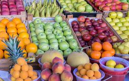 Summer fruits- apples, tangerines, melons, pineapples, peaches. For sale royalty free stock photography
