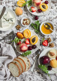 Summer fruits - apricots, peaches, plums, cherries, strawberries and blue cheese, honey, walnuts on a light stone background. Heal. Thy, diet, vegetarian food stock images