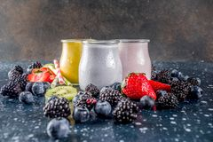 Summer fruits and berries smoothie. Drink. Vitamin diet snack beverage, with blueberries, strawberries, blackberries, kiwi. Dark blue concrete background copy royalty free stock photos