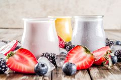 Summer fruits and berries smoothie. Drink. Vitamin diet snack beverage, with blueberries, strawberries, blackberries, kiwi. Dark blue concrete background copy stock images