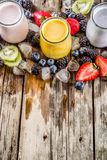 Summer fruits and berries smoothie. Drink. Vitamin diet snack beverage, with blueberries, strawberries, blackberries, kiwi. Dark blue concrete background copy royalty free stock photo